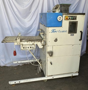 Fortuna KM head machine
